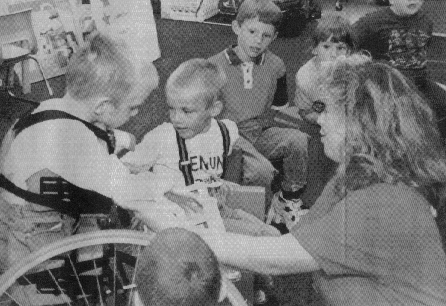 Teacher Susan M. McCullen works with Eric and Aaron Bissell during a preschool class. Photo by Mike Castagnaro