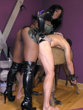 Awesome Black Mistress Punishes Her masked slave with a Strap On Dildo