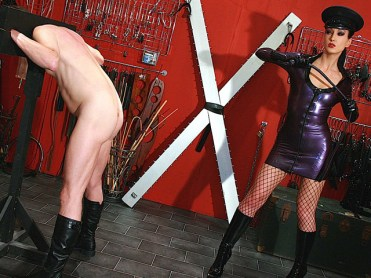 Awesome Latex Domina Liza Whips a slave in Stocks