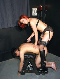 Awesome Redhead Mistress Spanks a slave and Gets Her Feet Licked