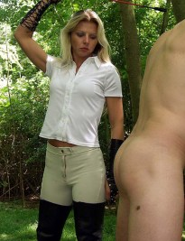 Blond Equestrian Domina Whips and Trashes a naked slave in the Woods