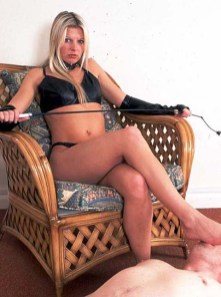 Cruel Mistress in PVC Gloves Trains Her slave and Gets Her Feet Licked