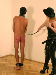 Cruel Mistress in Thigh High Boots Degrades and Whips Her slave Hard