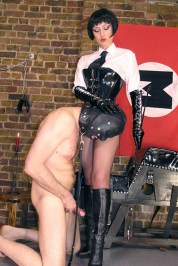 Fetish Liza in a Black Wig Tramples a slave and Gets Cum on Her Boots