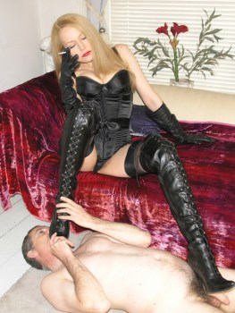 Hot Blond Dominatrix Slaps and Uses Her naked slave as Human Ashtray