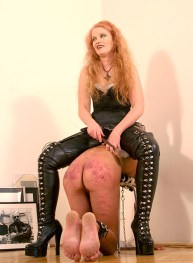 Hot Cruel Dominatrix Sits on Her naked male slave and Beats him Hard