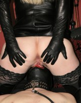 Mistress Sidonia Disciplines and Facesits a hooded slave in the Dungeon