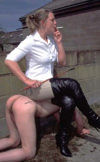 Riding Dominatrix Uses Her naked male slave as Human Ashtray and Chair