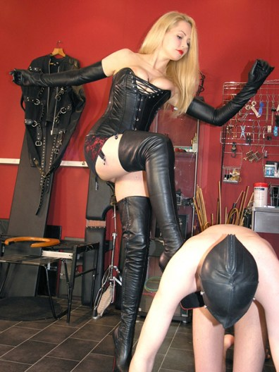Sexy Blond Dominatrix Degrades, Tramples and Slaps a slave in the Dungeon