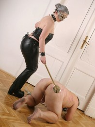 Sexy Masked Domina in Leather Spanks and Humiliates Her naked slave