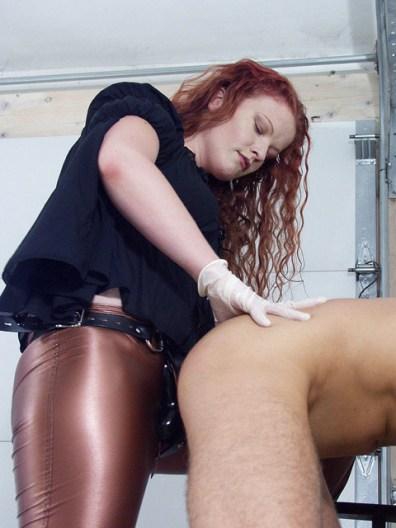Sexy Redhead Dominatrix Humiliates and Strap On Fucks a gagged slave