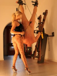 Two Cruel Mistresses Whip and Dominate a suspended and masked slave