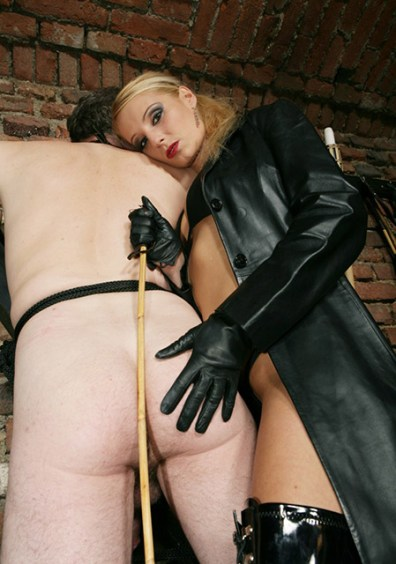 Young Blond Domina in Leather Restrains Her slave on St