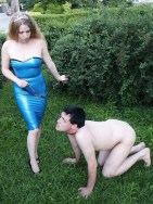 Young Mistress in Blue Latex Trains Her dog slave