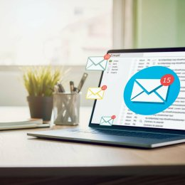 New email alert on laptop, communication connection message to global letters in the workplace.