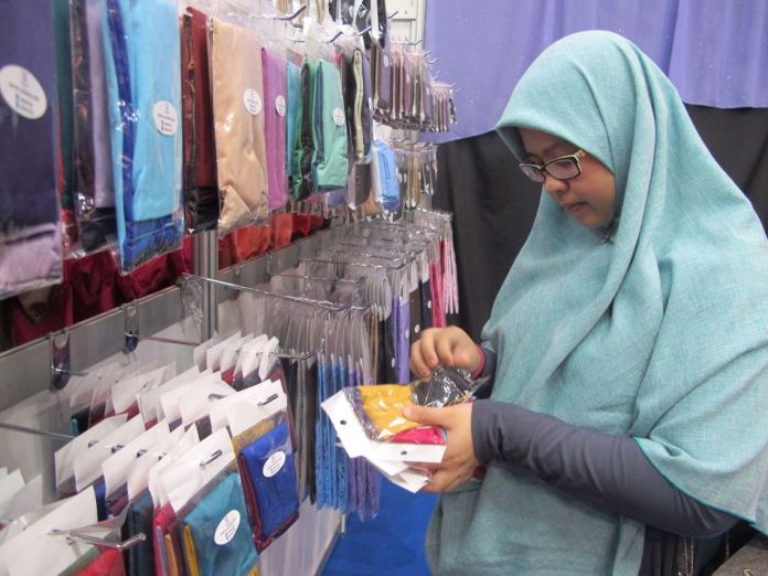 A customer browsing through Afeera BN hand sleeves at a pop-up event recently.