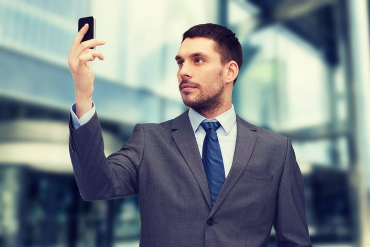 Businessman does video chat using smartphone