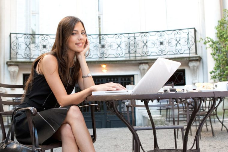 Female entrepreneur working outdoor using virtual services and cloud apps