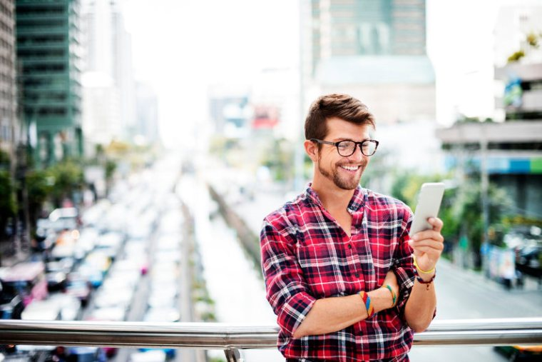 Businessman reading website content from smartphone