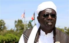 Malik Obama, half-brother of U.S. President Barack Obama, speaks during an interview with Reuters on Obama's re-election as U.S. President in his ancestral home village of Nyangoma Kogelo