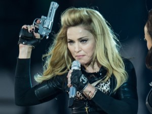 madonna-flaunted-pistols-and-ak47s-just-hours-after-the-colorado-shooting