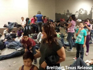 Photo: Breitbart Women and children from Central America crowd a detention center in Texas last week.