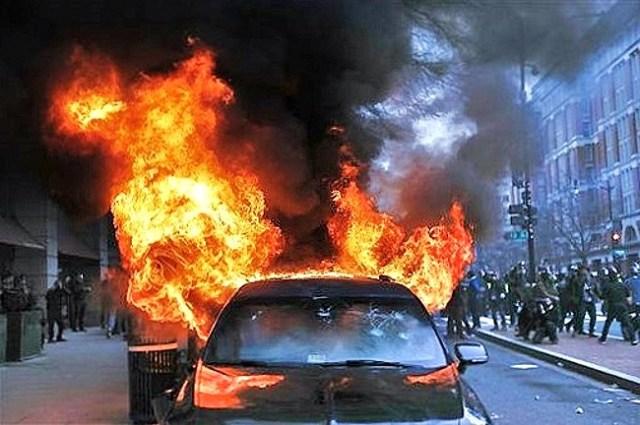 trump inauguration protest limo fire
