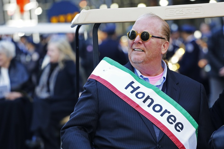 Chef Mario Batali rides in New York's Columbus Day Parade in 2016