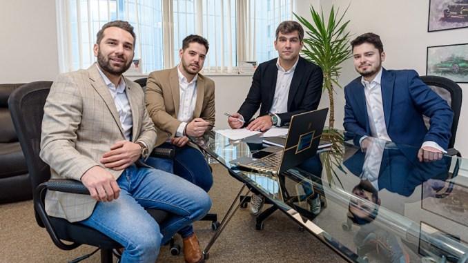 Flavian Popescu (stanga), Mircea Matei, Ovidiu Toma (CEO CryptoDATA Tech), Andrei Stănescu (dreapta)