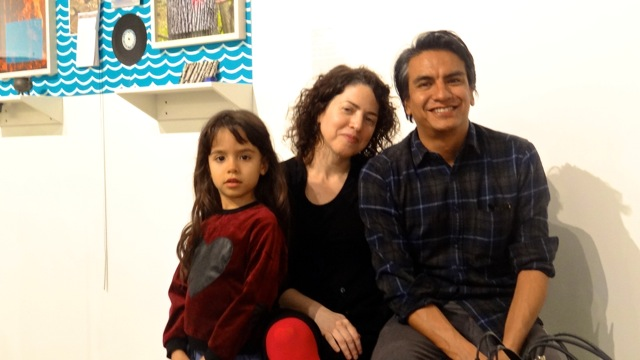 """Valerie Tavere (center) and Angel Nevrarez (right) with their daughter at BRIC Media Art House where they hosted """"Another Protest Song Karaoke"""""""