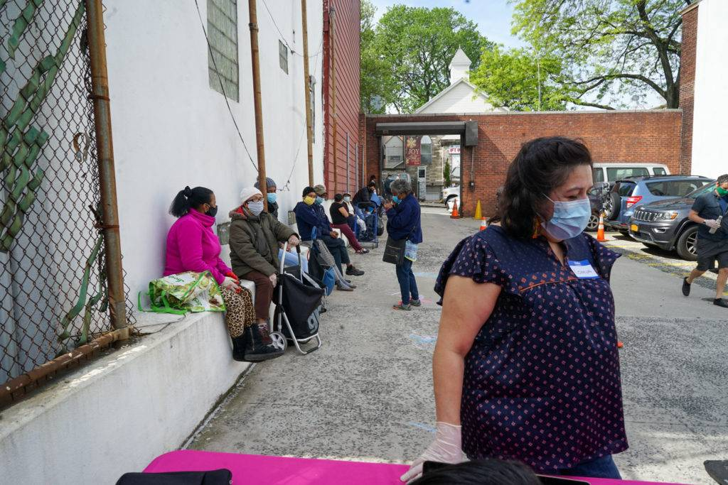 A line starts to form for the food collection around 9am each Saturday morning. Photo by Russell Frederick.