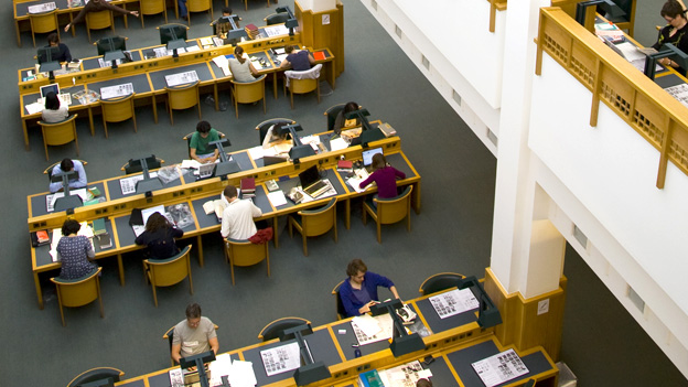 Desks in a British Library reading room.