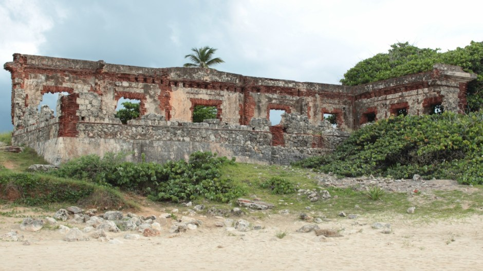 a view from the beach of the two remaining walls of the ponderosa lighthouse - a stark reminder of the risk of tsunami