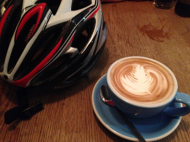 Photo of cycle helmet & coffee
