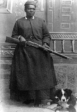 Mary Fields with her rifle