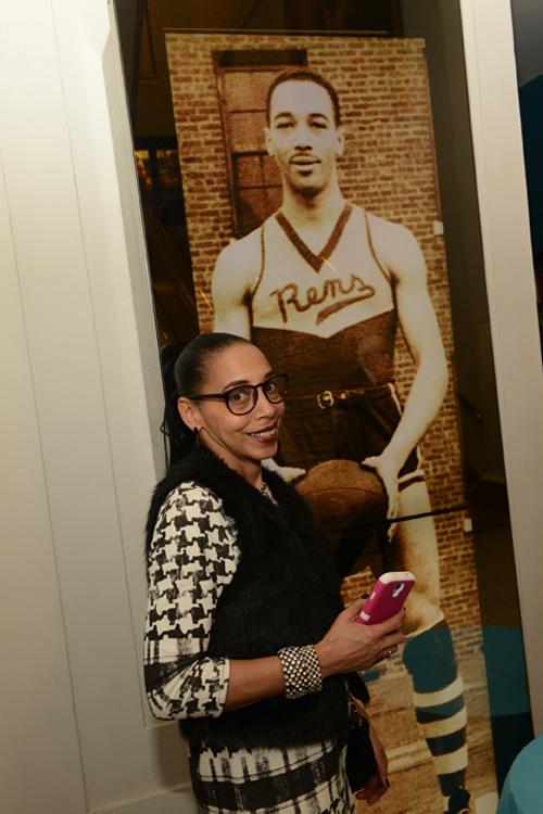 Karen Isaacs with a photo of her father John Isaacs