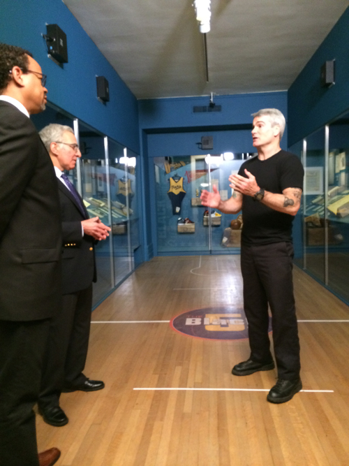 Show host Henry Rollins briefing Stephen Edidin and Claude Johnson.
