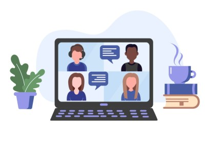 Laptop with several people in a virtual meeting windoow