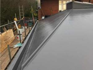 Slate grey Topcoat finish to roof area and gulleys 9