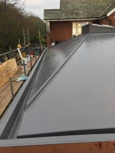 Slate grey Topcoat finish to roof area and gulleys.