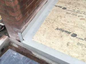 fix GRP perimeter trims and prepare edges for flashings. GRP FIbreseal Roof by Blackpool Industrial Roofing.