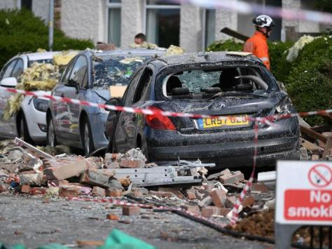 """Ben Norman, the Assistant Chief Fire Officer of Lancashire Fire and Rescue Service, said that fire crews remained at the scene and an investigation into the cause of the blast would be carried out """"slowly and methodically""""."""