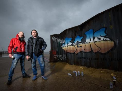 Graffiti artists Christian Seca One and Graham Morriss working on a crate on the Comedy Carpet to promote new Netflix movie Army of the Dead.