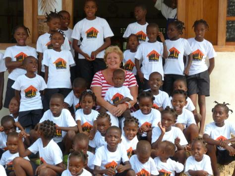 Sue Hayward with some of the children at the Happy House