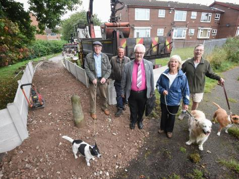 Grange Park residents welcome work carried out on a footpath prone to flooding