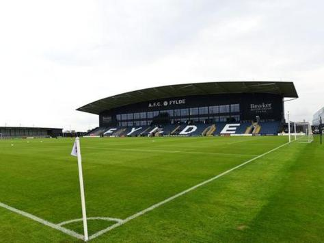 AFC Fylde has apologised after a number of its academy players allegedly squirted water pistols at members of the public in Kirkham