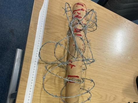A man has been arrested after a 'blood-spattered' baseball bat wrapped in barbed wire - familiar to Walking Dead fans as villain Negan's spiky pal 'Lucille' - was seized by police in Fleetwood