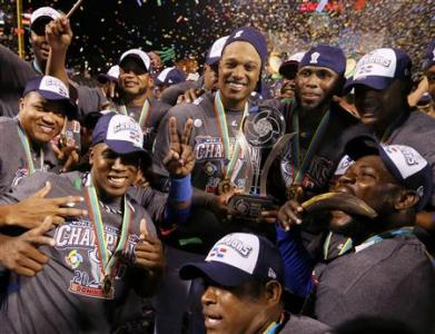 Players from the Dominican Republic celebrate with the trophy after they defeated Puerto Rico in the final to win the World Baseball Classic in San Francisco