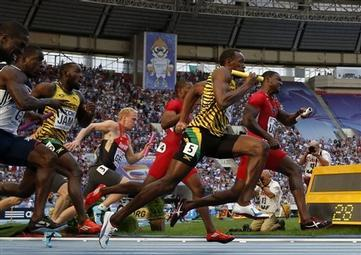 United States' Justin Gatlin, right, and Jamaica's Usain Bolt, second from right, run after receiving the baton in the men's 4x100-meter relay final at the World Athletics Championships in the Luzhniki stadium in Moscow, Russia, Sunday, Aug. 18, 2013. (AP Photo/Matt Dunham)