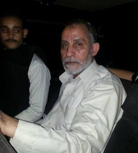 Mohamed Badie, right, in a photo that the police said was taken after his arrest in Cairo. (Courtesy of New York Times)